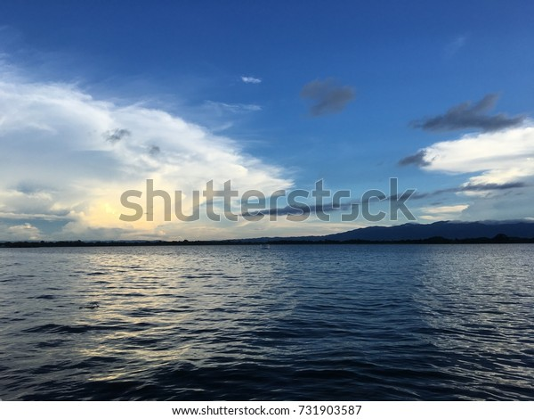 Pictures of lakes and skies near sunset.