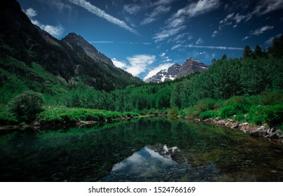 Pictures of the maroon bells in Aspen Colorado with nice reflections of the mountains on the lakes