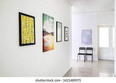 Pictures on wall in modern art gallery