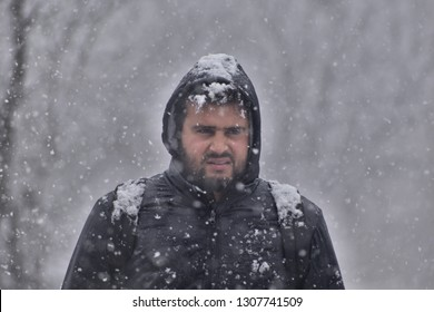 in Pictures, Photojournalist Shakir Wani perform his professional dety during heavy snowfall in Qazigund, Kashmir on 12 January 2019.