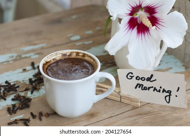 Pictures of sunny summer morning with beautiful flower, delicious turkish coffee on a rusted old table with decorations.
