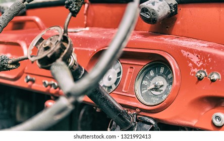 Pictures of vintage red car front panels.Focus on the car mile
