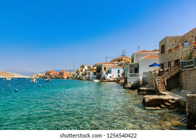 Picturescue colorful houses on embankment of Chalki Island, one of the Dodecanese islands of Greece, close to Rhodes.