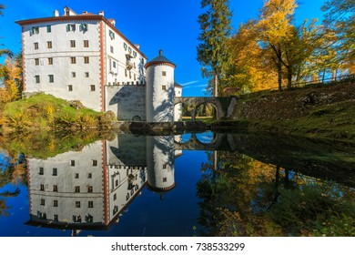 The picturesque 13th-century Sneznik Castle (Grad Snežnik, Schloß Schneeberg) reflecting in the pond, located in Loška Dolina, Slovenia