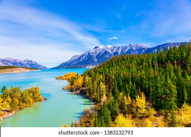 The picturesque Abraham lake in the mountain valley of the Rockies of Canada. Concept of active, ecological and photo tourism