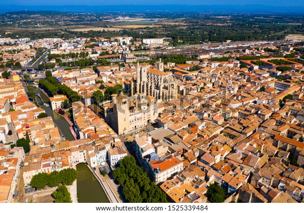 Picturesque aerial view of Narbonne cityscape overlooking ancient Gothic building of Cathedral of Saints Justus and Pastor, France