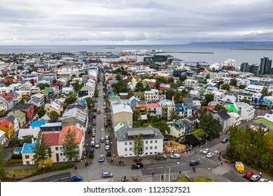 Picturesque aerial view of Reykjavik city, Iceland. Downtown, central street, mountains and ocean scenery beyond the city. View from the top of Hallgrimskirkja Cathedral in Reykjavik