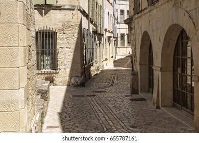 Picturesque alleyway in the small town of Uzes, South France