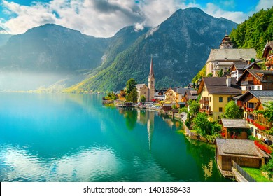Picturesque alpine village touristic location. The best well known famous old alpine village with spectacular misty lake and wooden houses, Hallstatt, Salzkammergut region, Austria, Europe