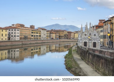 Picturesque Arno River embankment with colorful old houses in Pisa. Pisa, Tuscany, Italy, Europe.