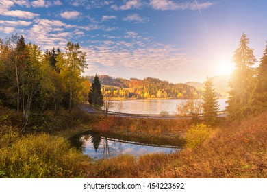 Picturesque autumn landscape with yellow trees, blue cloudy sky and reflection in the water, National park Slovak paradise, Slovakia - Shutterstock ID 454223692