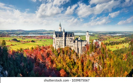 Picturesque autumn panorama of Neuschwanstein Castle (Schloss Neuschwanstein) in Fussen, Germany. Colorful morning scene in Bavarian Alps, Germany, Europe. Traveling concept background.