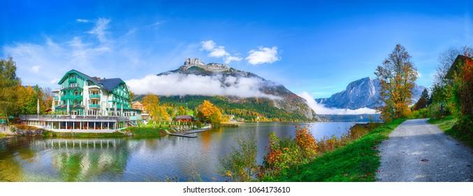 Picturesque autumn scene of Altausseer See lake. Sunny morning view of Altaussee village. Location: resort Altausseer see, Liezen District of Styria, Austria, Alps. Europe.