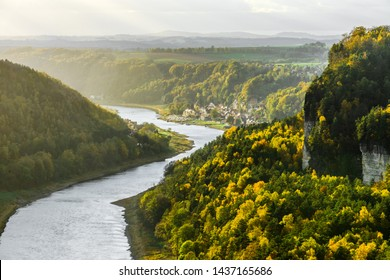Picturesque autumn sunset scenery of Stadt Wehlen town and Elbe river from Bastei bridge and Sandstone mountains, Saxon Switzerland National Park near Dresden, Germany