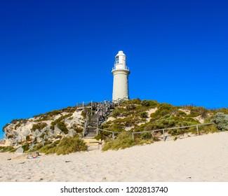 Picturesque Bathurst Lighthouse sitting on a hill in Pinkys Beach on Rottnest Island, Australia