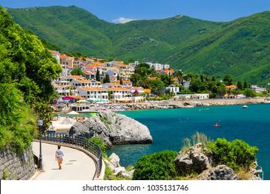 The picturesque city Herceg Novi, Montenegro, in the mountains, shore of Kotor. Scenic summer resort landscape in Herceg Novi. Spring, summer rest, vacation - Shutterstock ID 1035131746