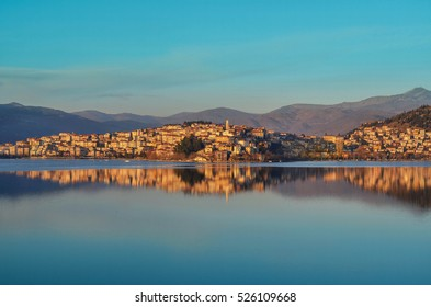 The picturesque city of Kastoria reflected on the lake of Orestiada.The lakeside city of north greece besides its rich history is wider known for the production and trade of furs and leather products
