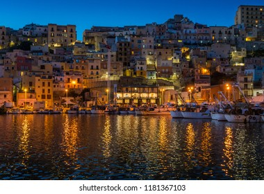 The picturesque city of Sciacca in the evening overlooking its harbour. Province of Agrigento, Sicily.