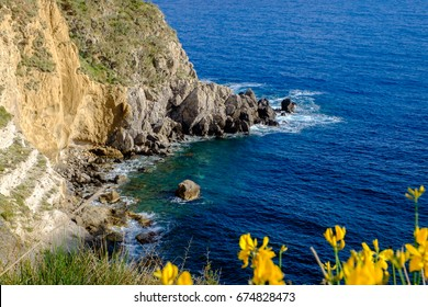 Picturesque cliff view near Thermal Spring of Sorgeto Bay, Ischia Island, Italy.