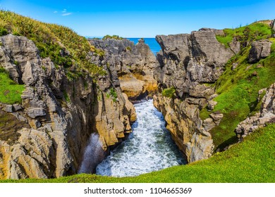 Picturesque coast of the South Island of New Zealand. Pancake rocks form narrow bays and fjords. The concept of photo and ecological tourism