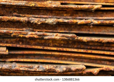 Picturesque curved sheets of rusty metal. Curved rusty sheets of metal. Industrial abstraction. Abstract corroded colorful rusty metal background, rusty metal texture.