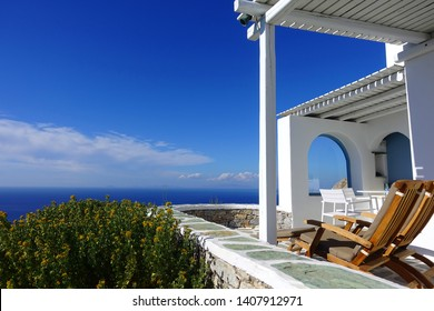 Picturesque cycladic architecture residences with stunning view to the Aegean blue sea in chora, main village of Folegandros island, Cyclades, Greece