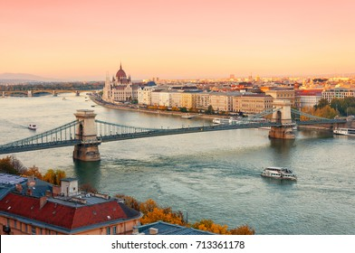 Picturesque dusk scenery of the Chain Bridge, the Parliament building and city historical downtown over the Danube river, Budapest, Hungary.