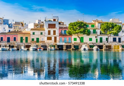 Picturesque fisherman port with colorful houses at Porto Colom, Spain Majorca, Mediterranean Sea Island.
