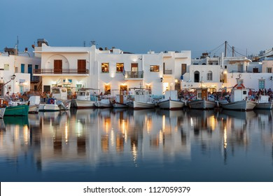 The picturesque fishing village of Naoussa on the island of Paros, Cyclades, Greece, during evening time