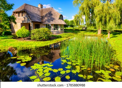 """Picturesque Giethoorn village in Netherlands, called """"Dutch Venice"""", famous for its many canals and waterways"""