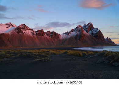 Picturesque and gorgeous scene.lit by the sunrise Vestrahorn mountain change it's colour, iceland