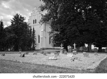 Picturesque graveyard with erased names on the tombstones. Black and white photography.