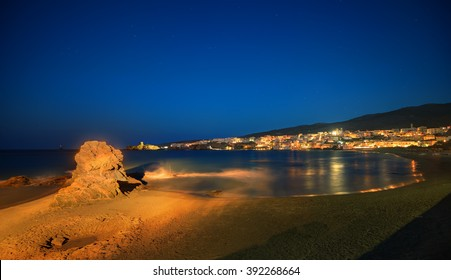 Picturesque Greek islands' town of Chora in Andros, Cyclades, viewed at dusk