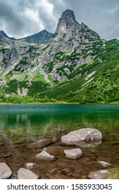 """Picturesque """"Green Pond"""" (Zelene Pleso Kezmarske) in Slovakian High Tatra mountains with Jastrabia Veza peak towering in the background. Slovakia, Europe. - Shutterstock ID 1585933045"""