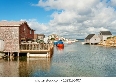 Picturesque houses and fishing boats in Peggys Cove village, Nova Scotia