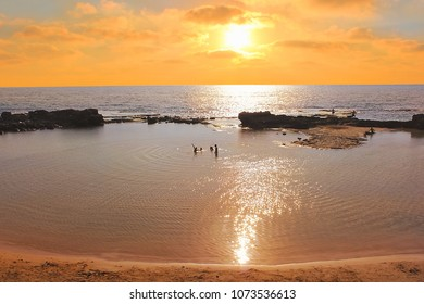 picturesque lagoon at sunset time in the National Park Achziv, Western Galilee, Israel