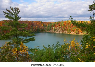 Picturesque lake in Gatineau Park photographed in autumn; part of the National Capital region of Canada