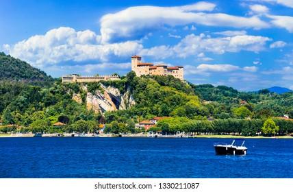 Picturesque lake Lago Maggiore, view of Rocca di Angera castle. northen Italy