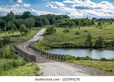 Picturesque landscape, Bridge over the pond in the countryside