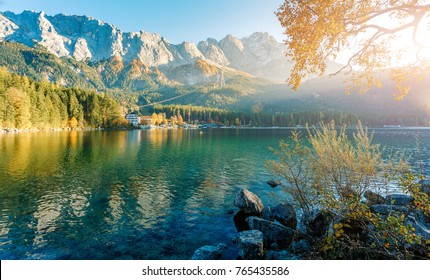 Picturesque Landscape and gorgeous scene. Alpine landscape with German Alps mountain Zugspitze reflected in the Eibsee lake on a sunny day. Majestic Autumn Scenery.  Eibsee, Bavaria. Impressive View