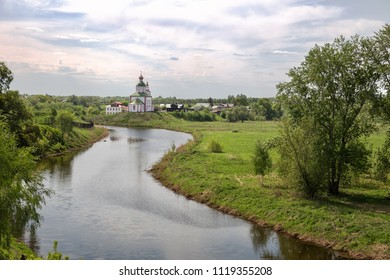 Picturesque landscape, Kamenka River and Elijah Church on hill, Suzdal, Russia