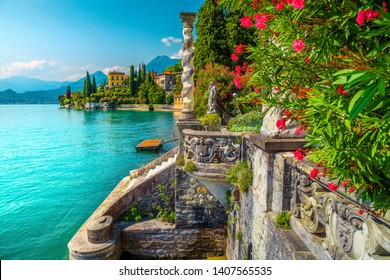 Picturesque landscape with lake and mediterranean buildings. Fresh oleander flowers and beautiful ornamental garden with villa Monastero, lake Como, Varenna, Lombardy region, Italy, Europe