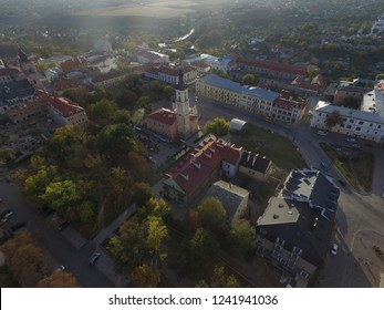 Picturesque landscape with Old Town of Kamianets-Podilsk. Ancient city with high tower of town-hall and mighty fortress on background, aerial summer view. City is a popular touristic destination.