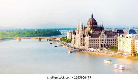 The picturesque landscape of the Parliament and the bridge over the Danube in Budapest, Hungary, Europe in pastel colors