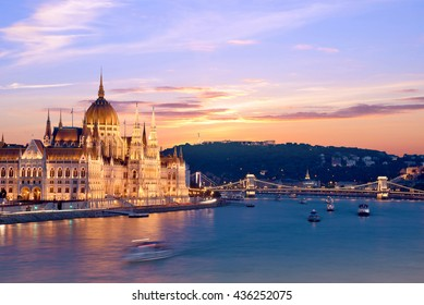 The picturesque landscape of the Parliament and the bridge over the Danube in Budapest, Hungary, Europe at sunset