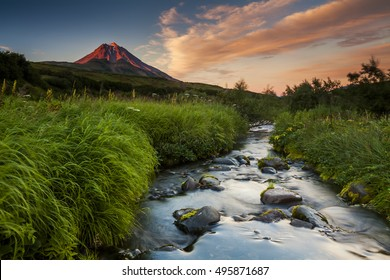 Picturesque landscape with river and volcano. Kamchatka peninsula