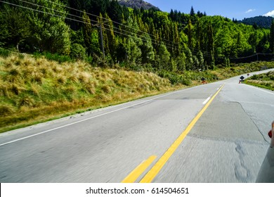 Picturesque landscape scene and blue sky above asphalt road, motion blur speed effect .
