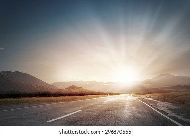Picturesque landscape scene and sunrise above road - Shutterstock ID 296870555