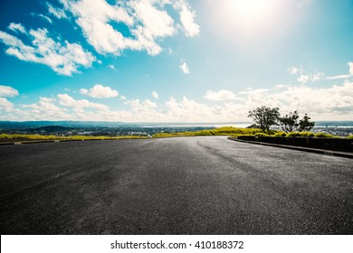 Picturesque landscape scene and sunrise above road