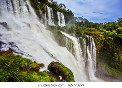Picturesque ledges form the famous waterfalls. Complex of waterfalls Iguazu on the border of Argentina, Brazil and Paraguay. The concept of extreme and ecological tourism